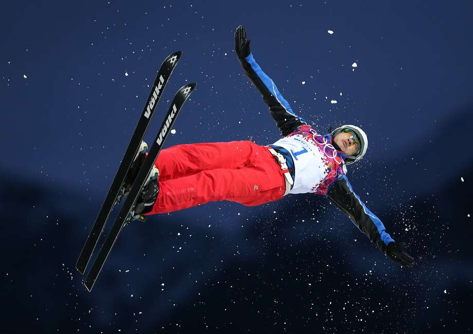 China's Liu Zhongqing jumps during men's freestyle skiing aerials qualifying at the Rosa Khutor Extreme Park, at the 2014 Winter Olympics, Monday, Feb. 17, 2014, in Krasnaya Polyana, Russia. Photo: Sergei Grits, Associated Press
