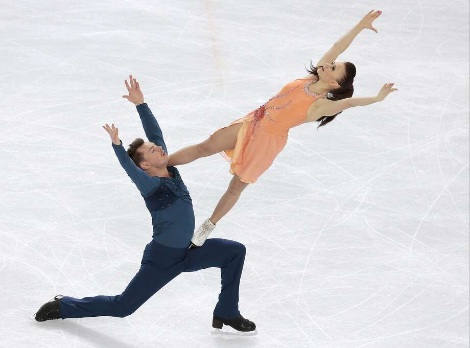 Julia Zlobina and Alexei Sitnikov of Azerbaijan compete in the ice dance free dance figure skating finals at the Iceberg Skating Palace during the 2014 Winter Olympics, Monday, Feb. 17, 2014, in Sochi, Russia. (AP Photo/Ivan Sekretarev) Photo: Ivan Sekretarev, Associated Press