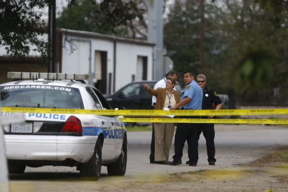 At least one person was shot and rushed to the hospital Monday morning during a robbery in northwest Houston. (Cody Duty / Houston Chronicle)