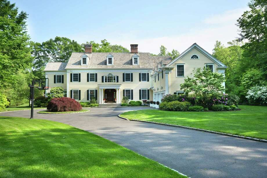 A nearly quarter-mile-long driveway leads to the stately Colonial at 440 Michigan Road in New Canaan. It is on the market for $4,395,000. Photo: Contributed Photo, Contributed / New Canaan News Contributed