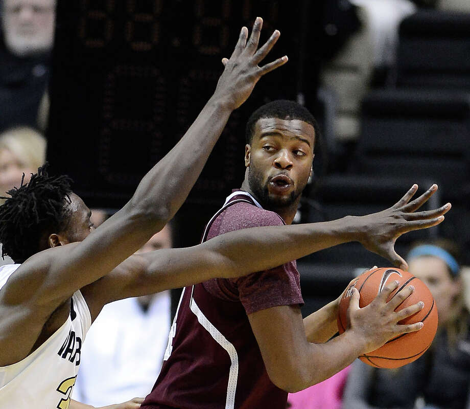 Texas A&M forward Antwan Space (24) looks to pass the ball as he is defended by Vanderbilt forward James Siakam (35) in the second half of an NCAA college basketball game on Saturday, Feb. 15, 2014, in Nashville, Tenn. Vanderbilt won in overtime 57-54. (AP Photo/Mark Zaleski) Photo: Mark Zaleski, Associated Press / FR170793 AP