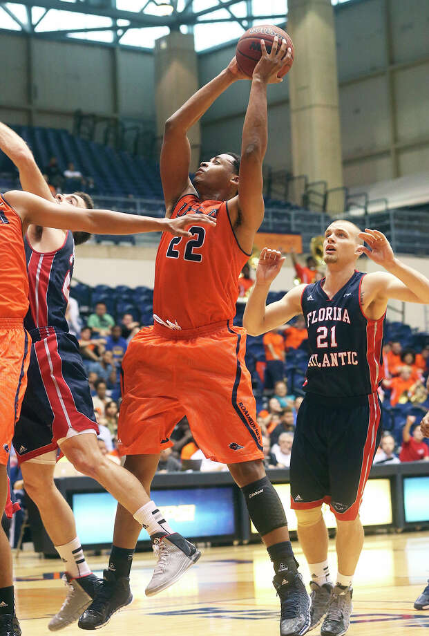 George Matthews grabs a high offensive rebound for the Runners as UTSA  plays Florida Atlantic in men's basketball at the UTSA Convocation Center on February 15, 2014. Photo: TOM REEL