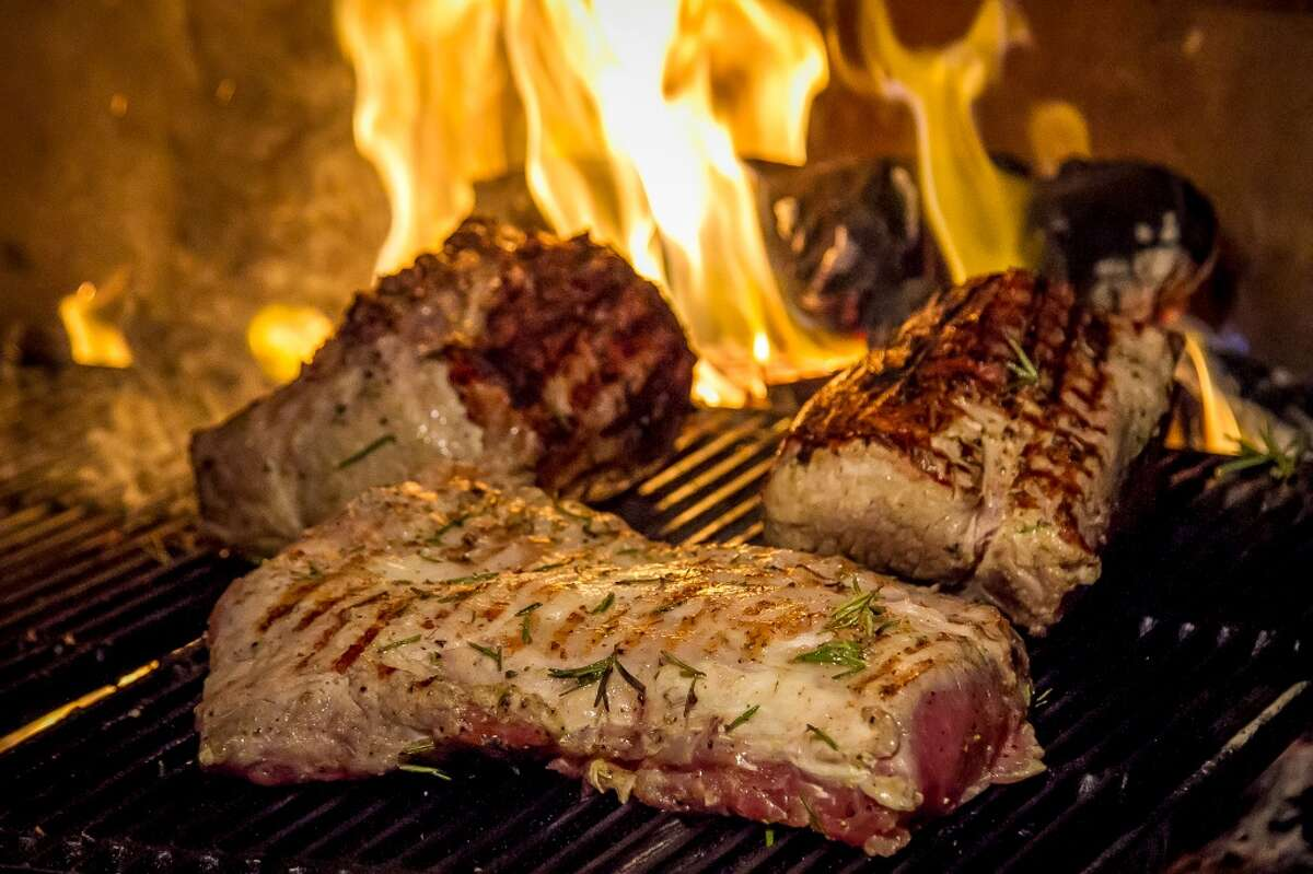 Pork Loin being grilled at Chez Panisse in Berkeley, Calif., is seen on Tuesday, February 11th, 2014.
