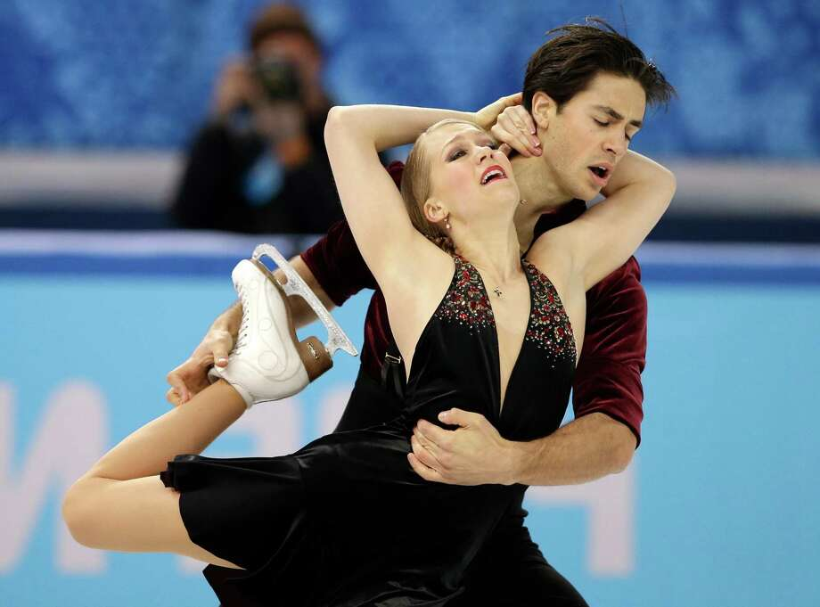 Kaitlyn Weaver and Andrew Poje of Canada compete in the ice dance free dance figure skating finals at the Iceberg Skating Palace during the 2014 Winter Olympics, Monday, Feb. 17, 2014, in Sochi, Russia. (AP Photo/Darron Cummings) Photo: Darron Cummings, Associated Press / AP