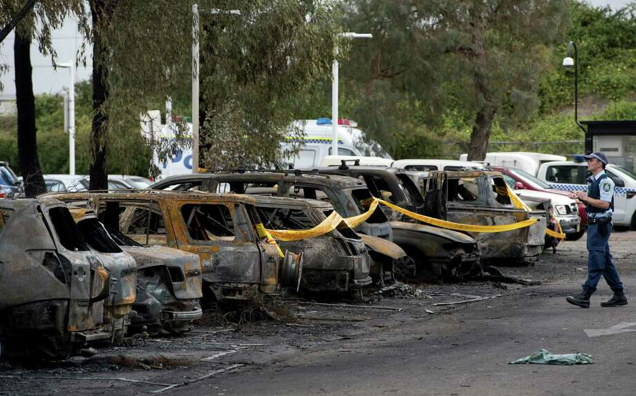 "Sydney 2000: In 2013, 80 cars were destroyed or badly damaged in a devastating fire at Sydney's Olympic Park which investigators on October 14 said was likely started by a ""stupid"" individual discarding a cigarette. Photo: SAEED KHAN, AFP/Getty Images / 2013 AFP"