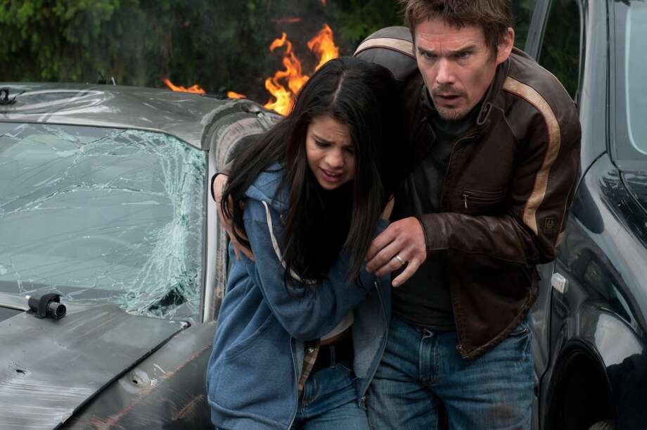 "Selena Gomez and Ethan Hawke in ""Getaway,"" 2013. Photo: Simon Versano, Warner Bros."