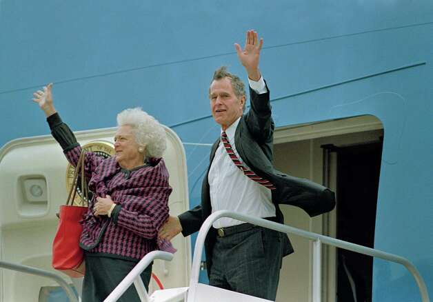 President  George H.W. Bush and Barbara Bush wave to supporters as they head back to Washington from Ellington Field in Houston on Wednesday, Nov. 4, 1992 after losing Tuesday's election to Arkansas Gov. Bill Clinton.  Photo: Ron Edmonds, ASSOCIATED PRESS / AP