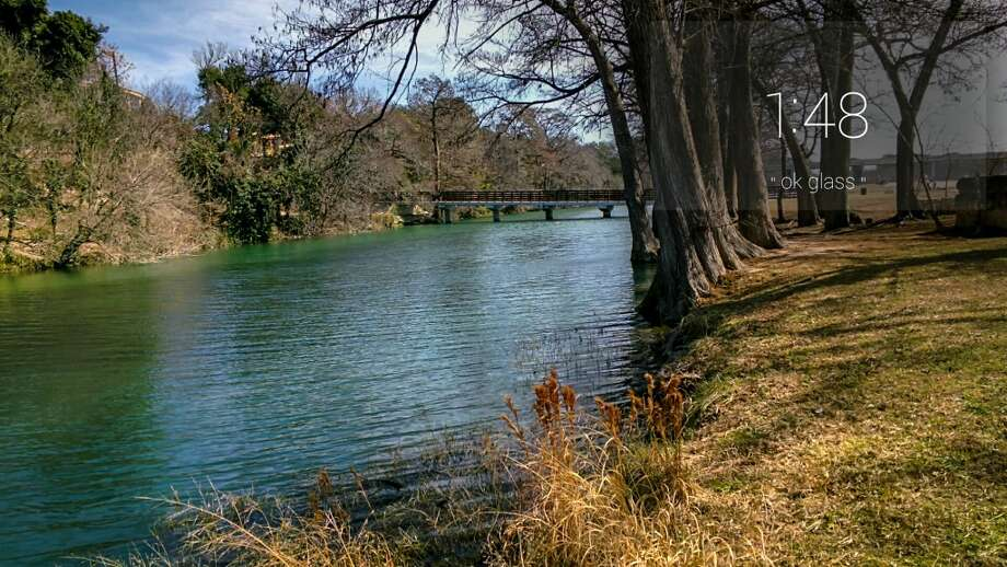 A bridge in the background over the Guadalupe River to Tranquility Island