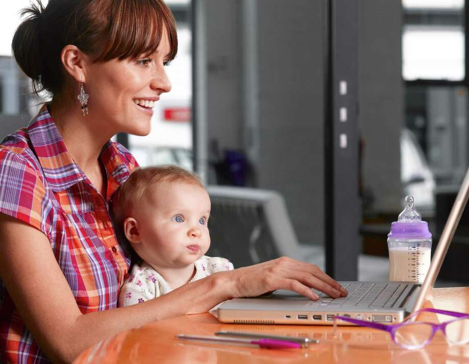 According to a new study, mothers of young children post to Facebook far less often than they did before their child's birth. Photo: Courtesy Peter Dazeley / (c) Peter Dazeley