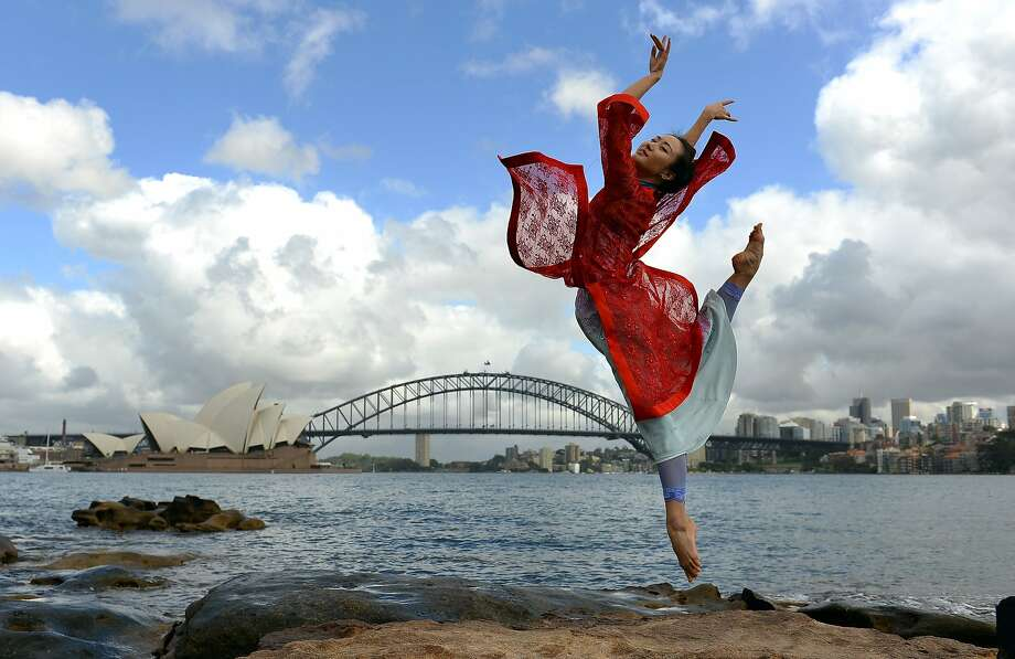 Dancing down under:Chinese ballerina Zhang Yashu performs during a photo shoot in front of Sydney landmarks the Opera House and Harbor Bridge. Photo: Saeed Khan, AFP/Getty Images