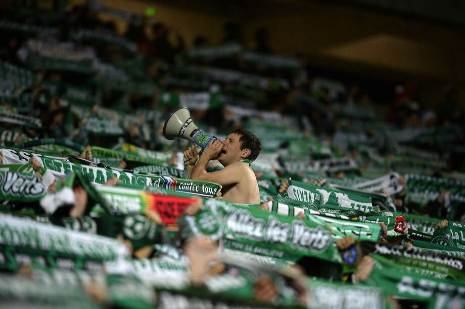 CAN I BORROW A SWEATER? An underdressed Saint-Etienne's supporter bellows in a megaphone during the soccer match between Saint-Etienne and Marseille at Geoffroy Guichard stadium in Saint-Etienne, France. Photo: Philippe Desmazes, AFP/Getty Images