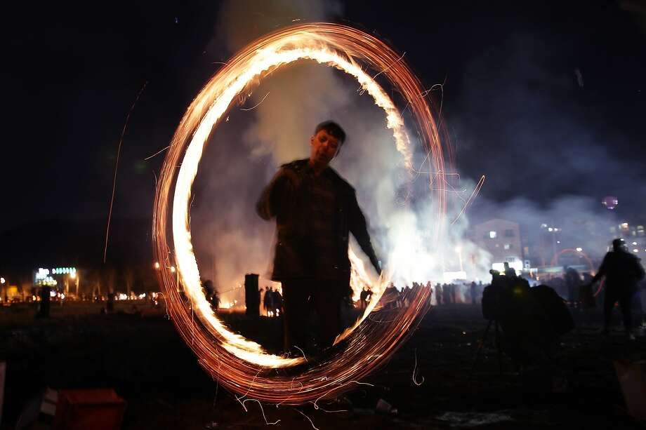 Spark lasso: In Yongin, South Korea, a man twirls fire cans during Jwibulnoli, a folk game played during the Daeboreum. Daeboreum is a Korean holiday celebrating the first full moon of the lunar new year. Photo: Chung Sung-Jun, Getty Images