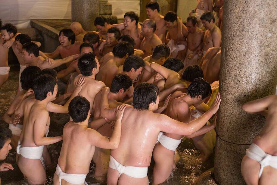 "Grab a lucky stick! Men in loincloths purify themselves in a cold fountain during the Hadaka Matsuri, or Naked Festival, at Saidaiji Temple in Okayama, Japan. To add to the fun, the men grab for a pair of ""lucky sticks"" thrown in the water by priests. Photo: Trevor Williams, Getty Images"