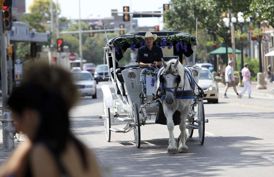 Trey Allenkamp of Lone Star Carriage Company strolls down Alamo Street with his horse, Leno, on Saturday, Sept. 11, 2010. Kin Man Hui/kmhui@express-news.net Photo: SAN ANTONIO EXPRESS-NEWS
