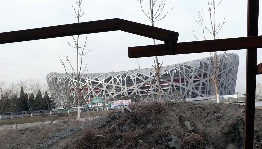 Beijing 2008: Many of Beijing's former Olympic venues are today unused. The Beijing National Stadium, shown here, is still used, even though it looks abandoned sometimes. Photo: Nozoomii, Flickr.com