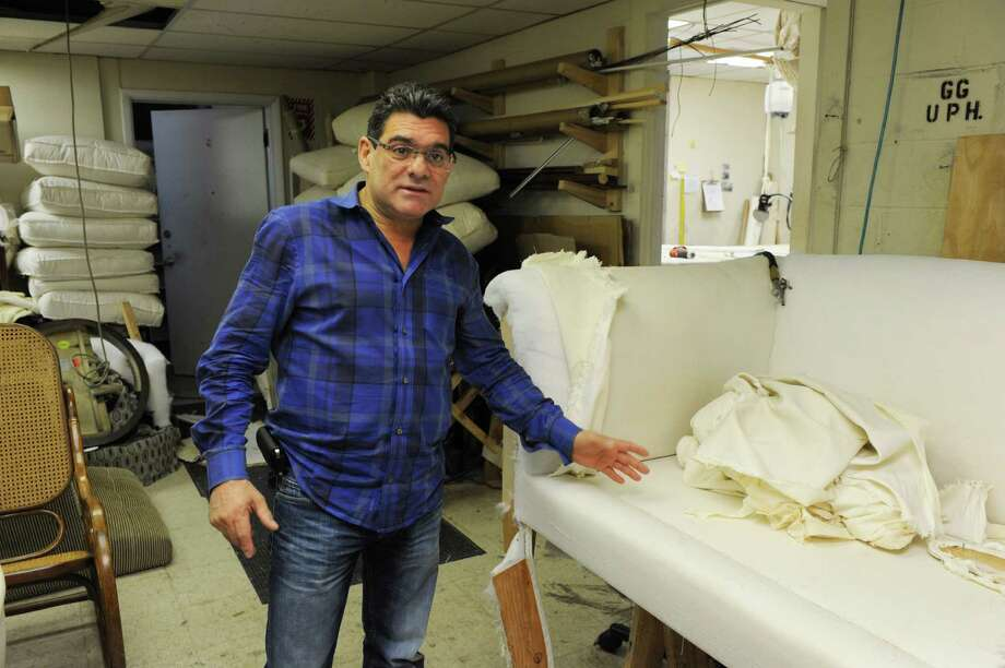 Gerardo Gonzalez show a couch that's in the process of being upholstered in his shop on Fairfield Ave in Stamford, Conn. on Monday February 17, 2014. Photo: Dru Nadler / Stamford Advocate Freelance
