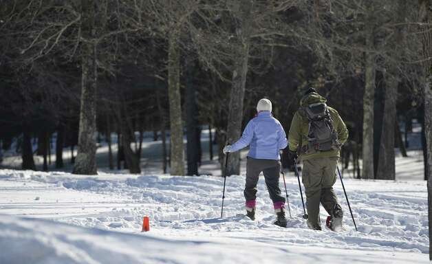 Kevin O'Connor, right, and Melanie Elmore of Waterford set off on their first snowshoe adventure Monday morning, Feb. 17, 2014, in Grafton State Park in Grafton, N.Y. This was the pairs first experience with using snowshoes.   (Skip Dickstein / Times Union) Photo: Skip Dickstein