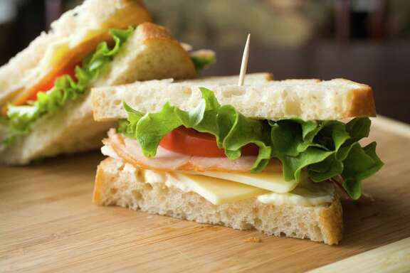 Turkey sandwich with cheese, lettuce, tomato and mayonnaise