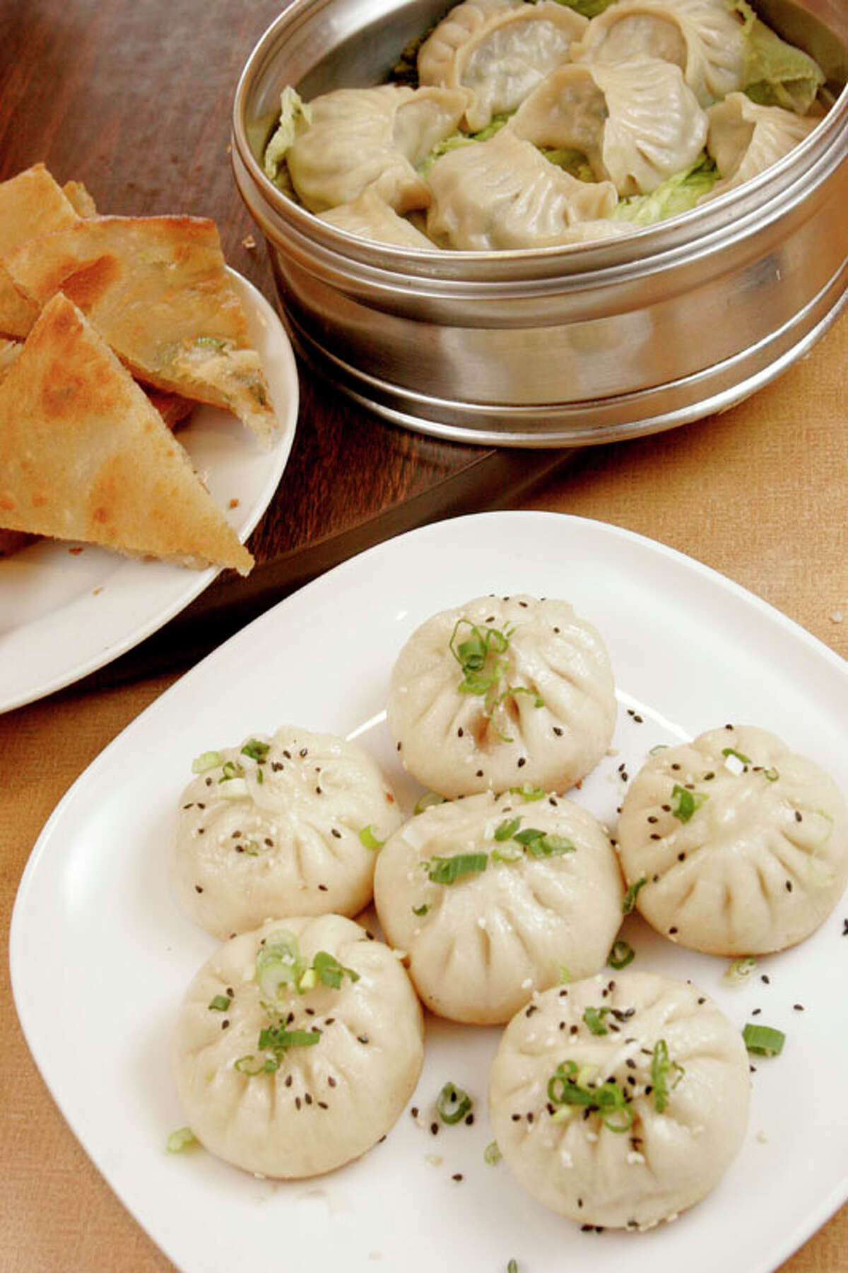 Fu Fu Cafe Cuisine: Chinese Dish: pan fried pork bun Entree price range: $ Where: 9889 Bellaire, No. 105 Phone: 713-981-8818