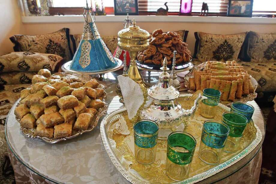 An assortment of desserts including baklawa and finger baklawa with a setting of green mint tea at Moroccan Bites Tagine, 5714 Evers Road, 210-706-9700 featured on 'Diners, Drive-Ins and Dives.' Photo: Marvin Pfeiffer/Prime Time Newspapers