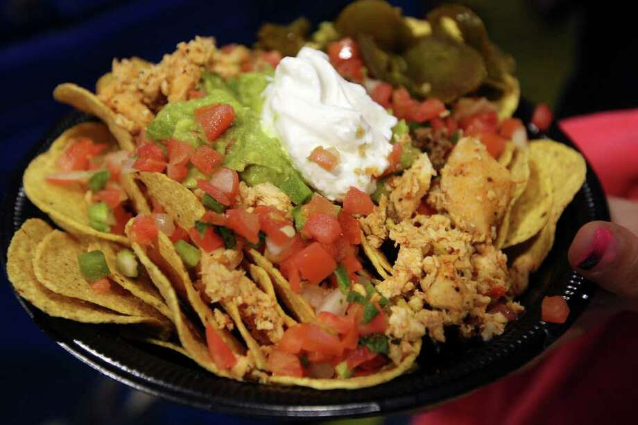 Extreme Nachos are served on a 16-inch pizza pie pan. The restaurant at 2102 Bandera Road was featured on Food Network's 'Outrageous Food.' Photo: Jerry Lara, San Antonio Express-News / © San Antonio Express-News