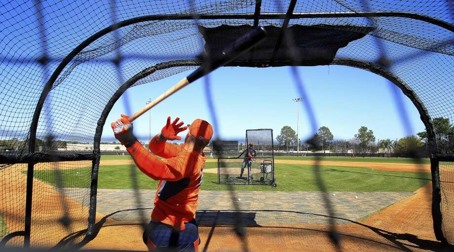 George Springer hits in the batting cages during workouts for early-arriving position players. Photo: Karen Warren, Houston Chronicle