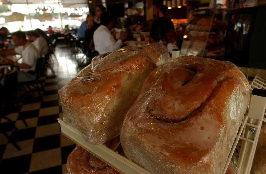 "Three-pound cinnamon rolls wait for buyers at Lulu's Bakery and Cafe in San Antonio. Adam Richman of Travel Channel's ""Man vs Food"" visited Lulu's Bakery, on 918 N. Main in 2009."