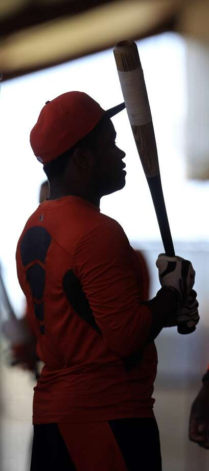Delino DeShields is silhouetted in the batting cages during workouts for early arriving position players. Photo: Karen Warren, Houston Chronicle