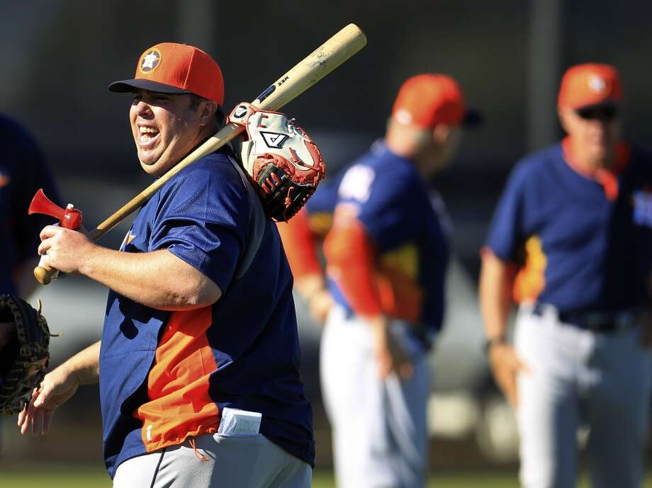 Astros bullpen coach Craig Bjornson laughs as players stretch during workouts for pitchers and catchers. Photo: Karen Warren, Houston Chronicle