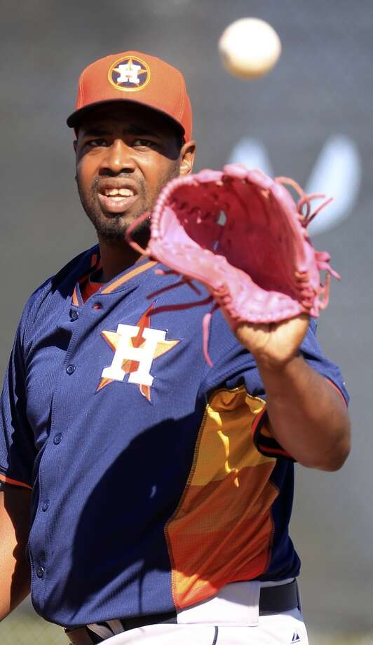 Jerome Williams with his pink glove as he pitched during workouts for pitchers and catchers on Monday. Williams uses the glove in honor of his mother, Deborah, who died of breast cancer in 2001. Photo: Karen Warren, Houston Chronicle