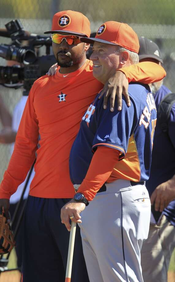 L.J. Hoes hugs Astros bench coach Dave Trembley during workouts for early-arriving position players. Photo: Karen Warren, Houston Chronicle