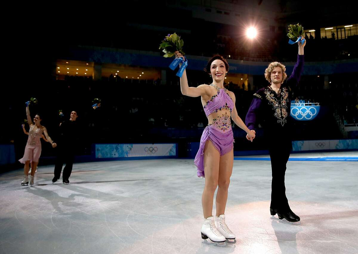 SOCHI, RUSSIA - FEBRUARY 17: Gold medalists Meryl Davis and Charlie White of the United States celebrate during the flower ceremony for the Figure Skating Ice Dance on Day 10 of the Sochi 2014 Winter Olympics at Iceberg Skating Palace on February 17, 2014 in Sochi, Russia. (Photo by Matthew Stockman/Getty Images) *** BESTPIX ***