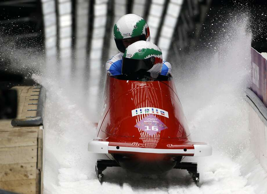 The team from Italy ITA-1, piloted by Simone Bertazzo and brakeman Simone Fontana, brake after their final run during the men's two-man bobsled competition at the 2014 Winter Olympics, Monday, Feb. 17, 2014, in Krasnaya Polyana, Russia. (AP Photo/Dita Alangkara) Photo: Dita Alangkara, Associated Press