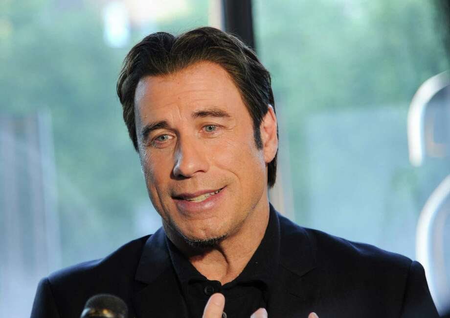 "Actor John Travolta attends a special screening of ""Killing Season"" hosted by Jagermeister at the Sunshine Landmark Theater on Thursday, June 20, 2013 in New York. (Photo by Evan Agostini/Invision/AP) Photo: Evan Agostini / Invision"