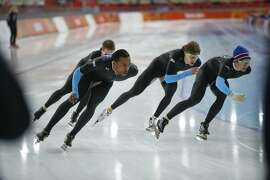 U.S. speedskaters Joey Mantia, rear left, Shani davis, front left, Brian Hansen, second right, and Jonathan Kuck, right, practice for the team pursuit at Adler Arena Skating Center during the 2014 Winter Olympics, Monday, Feb. 17, 2014, in Sochi, Russia. (AP Photo/Pavel Golovkin)