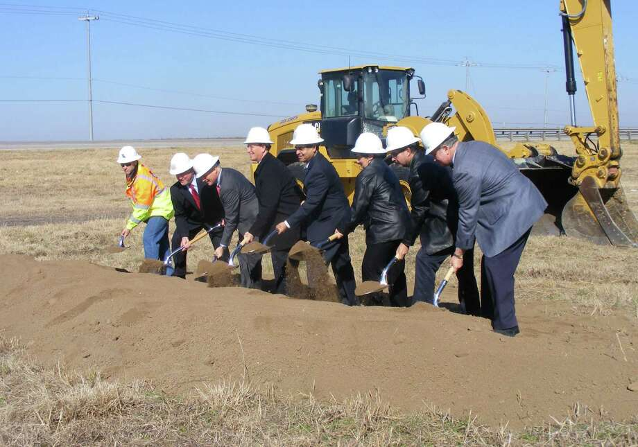 City, county and Texas Department of Transportation officials turns shovels of dirt near the site where Loop 1604 construction will soon begin. Photo: Jeff B. Flinn / NE Herald