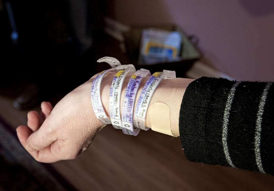 Kimberly Fugate shows off her identification bracelets for her four girls: Kenleigh Rosa, Kristen Sue, Kayleigh Pearl and Kelsey Roxanne. (University of Mississippi Medical Center)