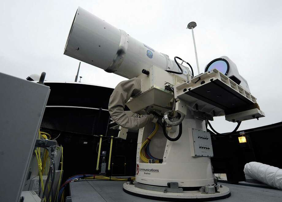 A laser weapon sits temporarily installed aboard the guided-missile destroyer USS Dewey in San Diego, Calif. The Navy plans to deploy its first laser on a ship this year. Photo: U.S. Navy / U.S. Navy