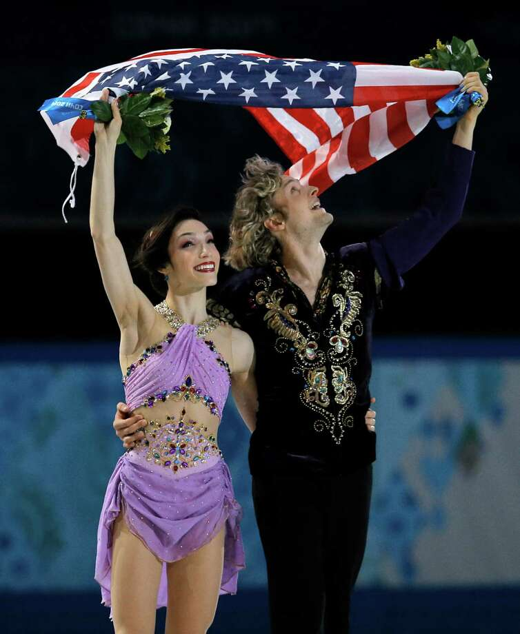 Meryl Davis and Charlie White of the United States celebrate after placing first in the ice dance free dance figure skating finals at the Iceberg Skating Palace during the 2014 Winter Olympics, Monday, Feb. 17, 2014, in Sochi, Russia.  (AP Photo/Vadim Ghirda) ORG XMIT: OLYFS503 Photo: Vadim Ghirda / AP