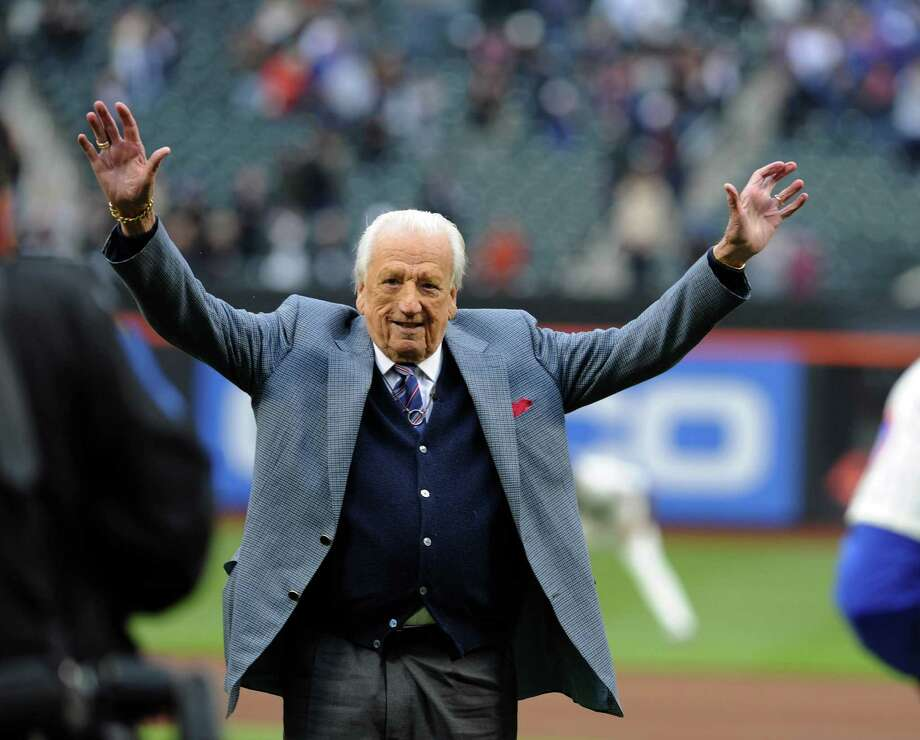 FILE -- Ralph Kiner waves to the crowd after throwing out the first pitch before the Washington Nationals-New York Mets game in New York, April 7, 2011. Kiner, a member of the Baseball Hall of Fame who led the National League in home runs for seven seasons in a row and was an announcer for the Mets for half a century, died Feb. 6, 2014, in Rancho Mirage, Calif., at age 91.  (Barton Silverman/The New York Times)   ORG XMIT: XNYT150 Photo: BARTON SILVERMAN / NYTNS