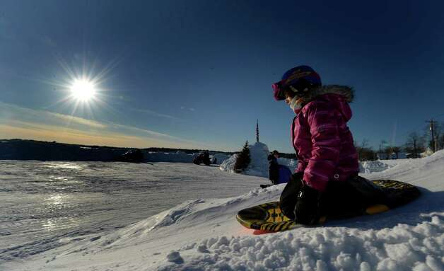 Julietta Rapisarda, 7, slides down a hill on to Saratoga Lake Monday afternoon Feb. 17, 2014, in Saratoga Springs, N.Y.  The snow slide on to the lake was sculpted by her grandfather Gary Bazar.  (Skip Dickstein / Times Union) Photo: SKIP DICKSTEIN