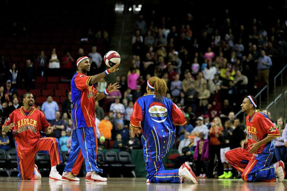 "The Harlem Globetrotters take to the hardwood to pull a host of tricks and sink baskets during their ""Fans Rule"" World Tour Monday, Feb. 17, 2014, at KeyArena in Seattle. The kid-friendly Globetrotters have thrilled families and millions of fans for 88 years. Photo: JORDAN STEAD, SEATTLEPI.COM / SEATTLEPI.COM"