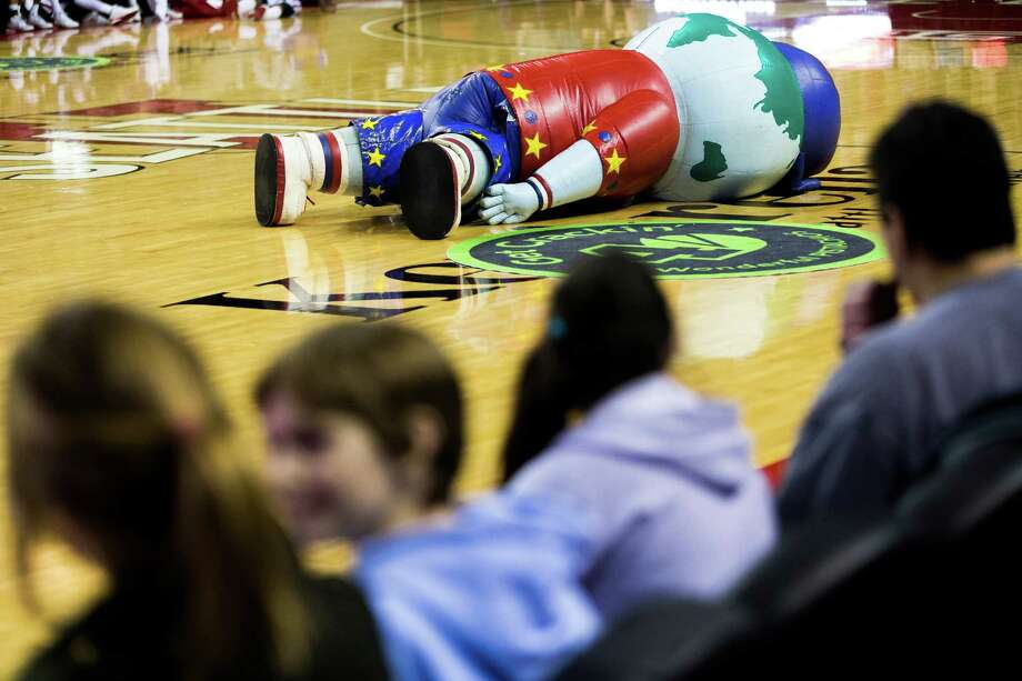 "Big G, one of two Harlem Globetrotter mascots, falls on his face during the ""Fans Rule"" World Tour Monday, Feb. 17, 2014, at KeyArena in Seattle. The kid-friendly Globetrotters have thrilled families and millions of fans for 88 years. Photo: JORDAN STEAD, SEATTLEPI.COM / SEATTLEPI.COM"