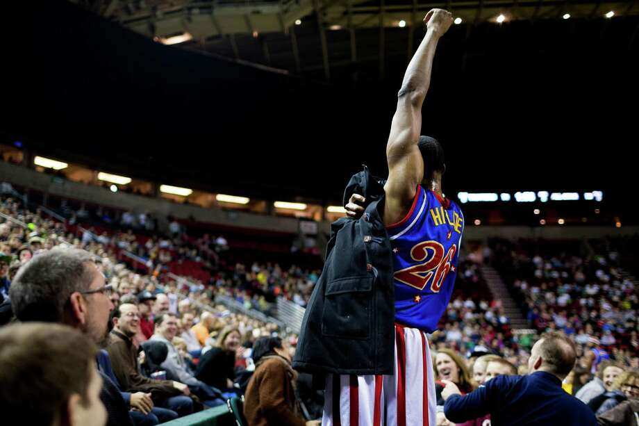 "Hi-Lite of the Harlem Globetrotters casually wipes his sweaty armpits with a jacket found in the crowd during the ""Fans Rule"" World Tour Monday, Feb. 17, 2014, at KeyArena in Seattle. The kid-friendly Globetrotters have thrilled families and millions of fans for 88 years. Photo: JORDAN STEAD, SEATTLEPI.COM / SEATTLEPI.COM"