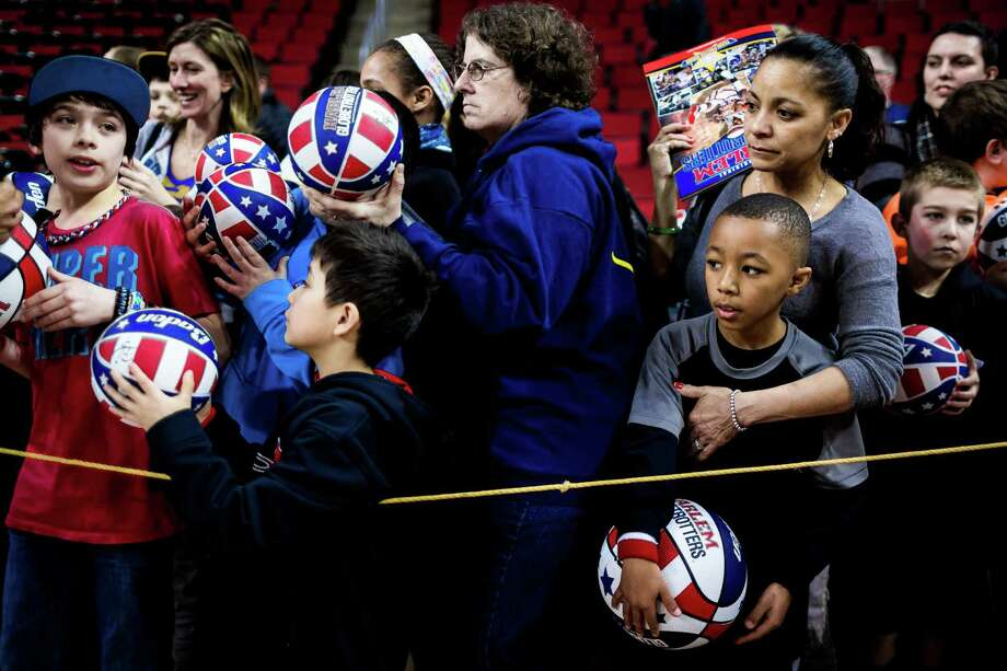 "Fans await the Harlem Globetrotters to sign autographs following the ""Fans Rule"" World Tour Monday, Feb. 17, 2014, at KeyArena in Seattle. The kid-friendly Globetrotters have thrilled families and millions of fans for 88 years. Photo: JORDAN STEAD, SEATTLEPI.COM / SEATTLEPI.COM"