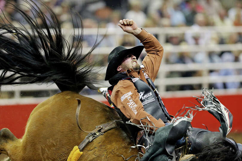 Steven Dent, of Mullen, NE, competes in the bareback riding event during the San Antonio Stock Show