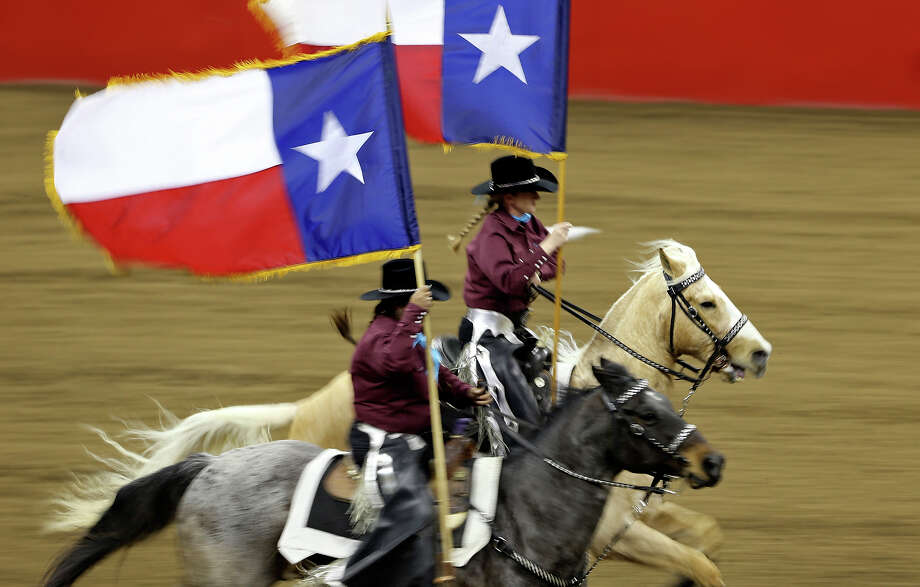 Members of the Palomino Patrol Drill Team take part in the grand entry during the San Antonio Stock Show & Rodeo Monday Feb. 17, 2014 at the AT&T Center. Photo: Edward A. Ornelas, San Antonio Express-News / © 2014 San Antonio Express-News