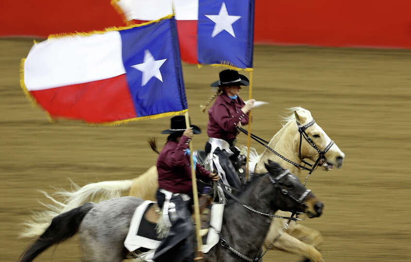 Members of the Palomino Patrol Drill Team take part in the grand entry during the San Antonio Stock