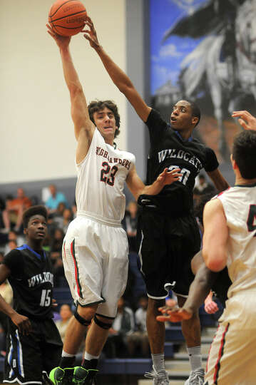 The Woodlands senior guard Aaron Kovach, from left, tries to get a shot off against Dekaney junior g