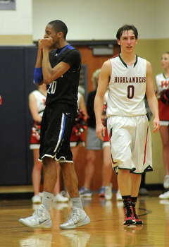 Dekaney 66, The Woodlands 56Dekaney junior guard Dervyn Baines, left, reacts to a three point foul called on him late in the 4th quarter of their Region II-5A playoff matchup versus senior guard Shane Moran (#0) and The Woodlands Highlanders at College Park High School on Monday. Photo: Jerry Baker, For The Chronicle